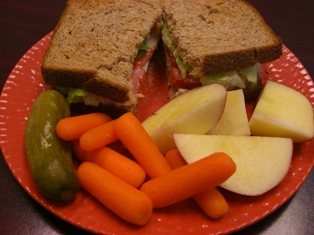 Lunch (Whole-Wheat Bread with Oven-Gold Turkey & White American Cheese with a little Mayo, Lettuce & Tomato and a Pickle, Baby Carrots & 1/2 an Apple on the side)