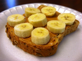 Peanut butter on whole grain bread with banana slices